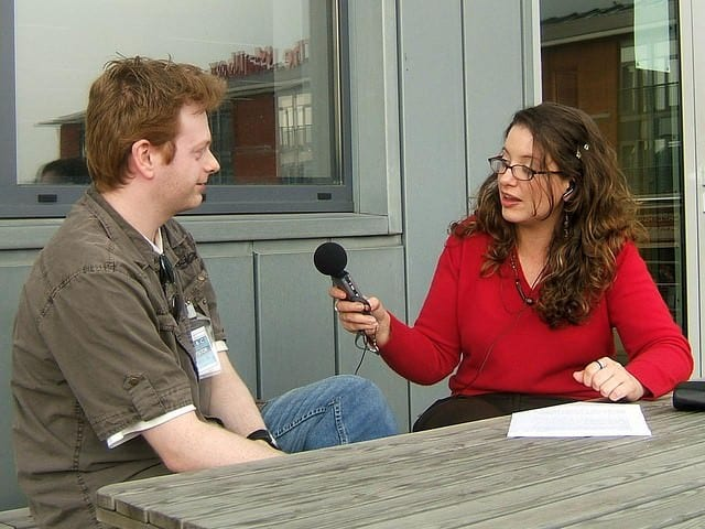 how to prepare for an interview, like this picture of a lady interviewing a man