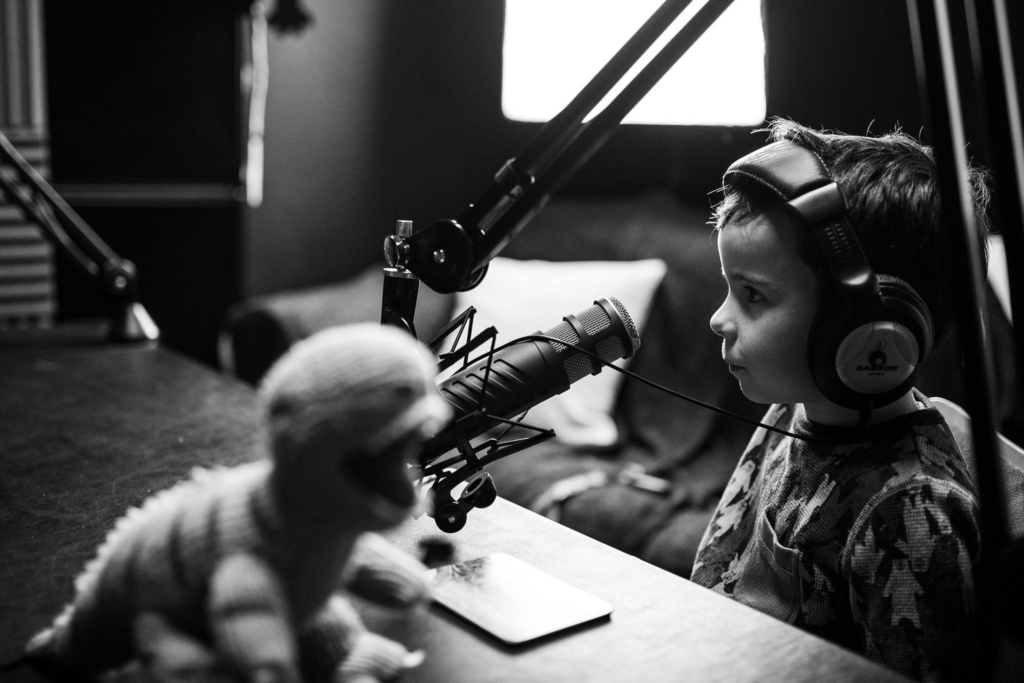 child listening with headphones using a microphone