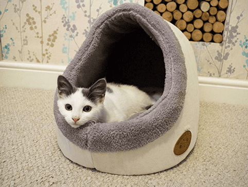 Soft, curved, hemispherical plush-lined cat bed, with a white and gray kitten.