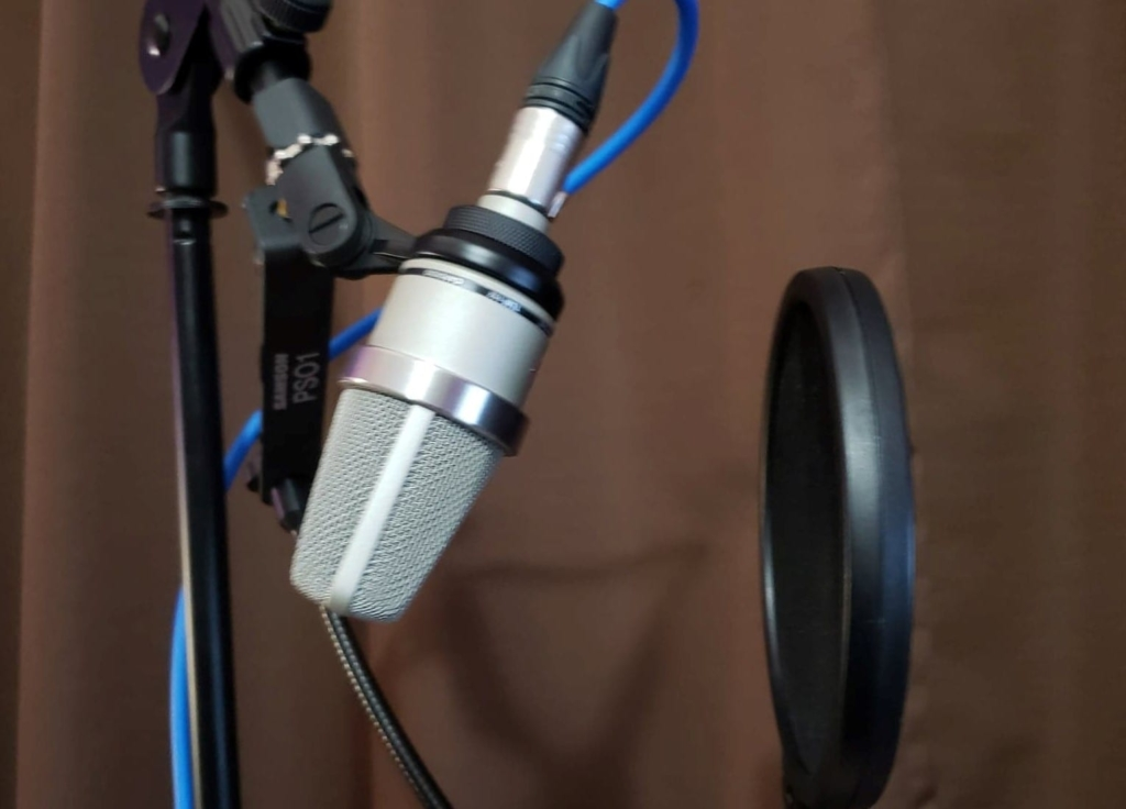 Pop filter setup to reduce plosive issues
